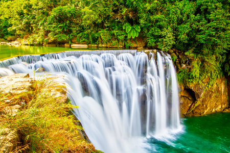Majestic Shifen Waterfall in Pingxi District of New Taipei City, Taiwan, on the upper reaches of the Keelung River. The famous cascading waterfall is the broadest in Taiwan.