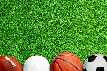 Top down view of football, volleyball, basketball and soccer ball on field with copy space. Banco de Imagens