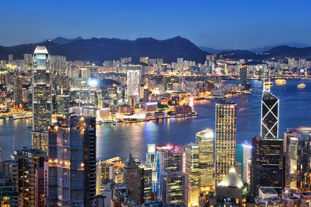 Sunset blue hour over Victoria Harbor in Hong Kong as viewed atop Victoria Peak