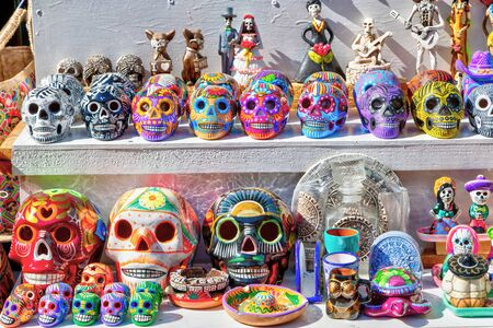 Typical Mexican Calaveras skulls decorated for Day of the Dead on sale as souvenirs at Playa del Carmen in Riviera Maya, Cancun, Mexico.