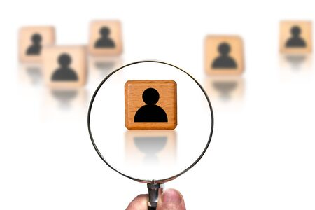 Concept of searching for a person, talent, potential employee using magnifying glass. Stock Photo