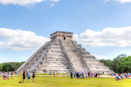 Unidentifiable tourists at the Temple of Kukulkan Pyramid at Chichen Itza, one of the largest ancient Maya cities discovered by archaeologists in Yucatan, Mexico. Also known as El Castillo, it is an UNESCO World Heritage Site and a new Seven Wonders of th 에디토리얼