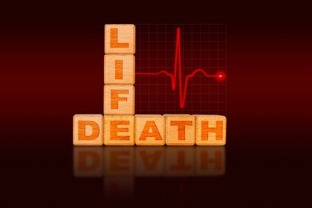 Life and death concept written on alphabet blocks in the form of a chart with ECG electrocardiogram showing strong heart beat initially followed by flat pulse indicating death.