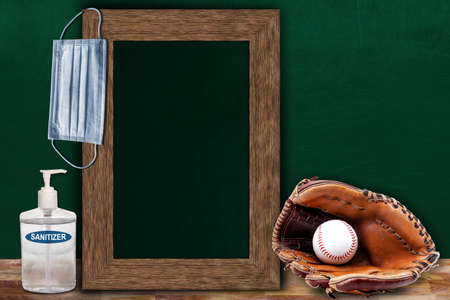 COVID-19 new normal sports concept in a classroom setting showing framed chalkboard with copy space and baseball glove and ball on wooden table. Banque d'images