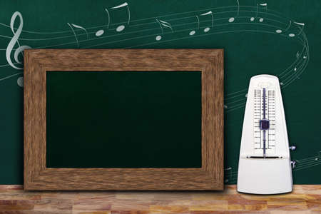Music class concept with musical notes on background chalkboard and wooden frame copy space next to white mechanical metronome. Banque d'images