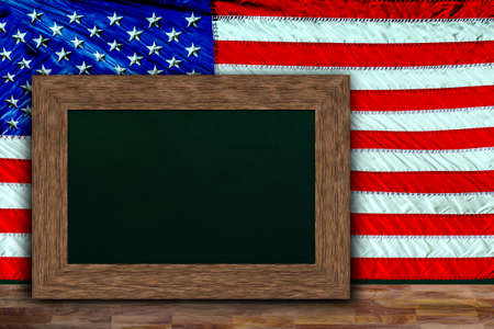 US flag hung behind wooden frame chalkboard for copy space. Concept for Indendence Day, Memorial Day, Remembrance Day, patriotism message.