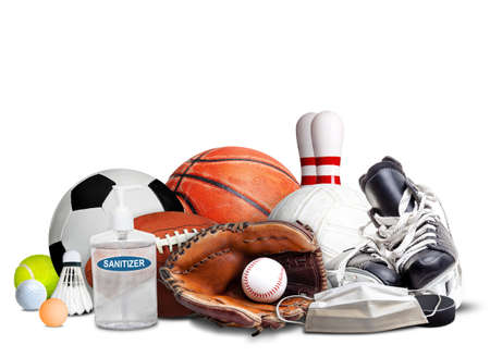 COVID-19 coronavirus new normal and sports concept showing sports equipment, rackets and balls with hand sanitizer and face mask isolated on white background and copy space. Banque d'images