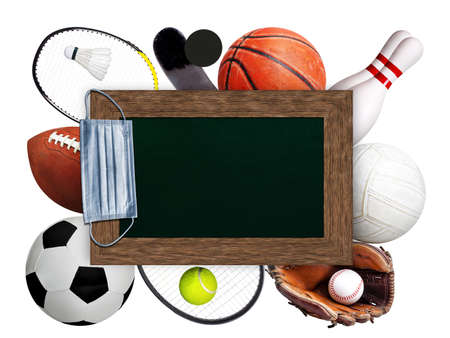 Framed chalkboard copy space with hanging medical face mask on top of sports balls and equipment on white background. Concept of sports during pandemic.
