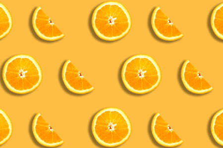 Fruit pattern with sliced oranges on orange background. Top view. Summer concept. Banque d'images