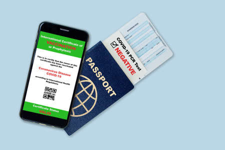 Smartphone on travel passport, boarding pass with digital certificate of COVID-19 vaccination and proof of negative COVID test result. Concept of new normal future air or land border travel restrictions and requirements. Fake QR code. Reklamní fotografie