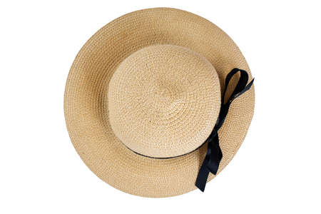 Top down view of straw hat with black bow ribbon isolated on white background. Popular summer beach and vacation casual wear.
