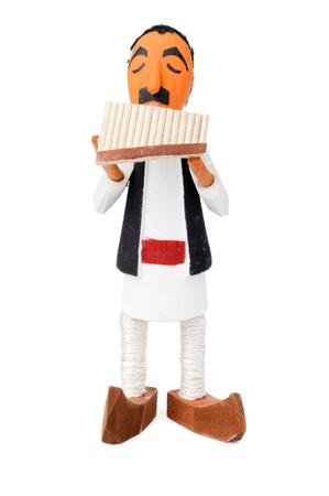 zampona: Muñeca de madera que canta en el Pan-pipe Foto de archivo