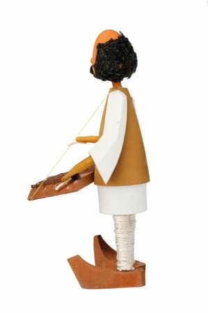wooden doll that sings at dulcimer