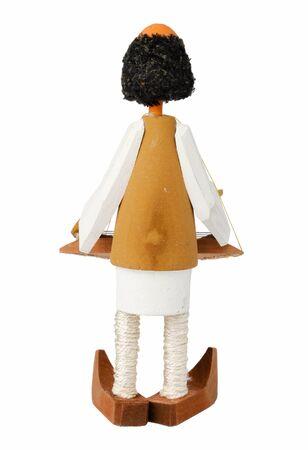 wooden doll that sings at dulcimer