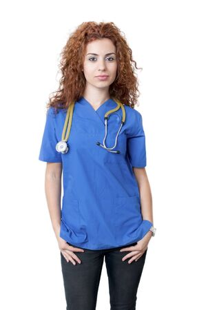 Young female doctor smiling in blue uniform Stock Photo
