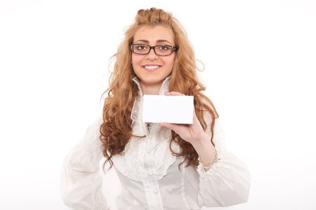 Young business woman holding white empty paper sign