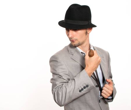 Handsome young caucasian businessman pulling out a machete from his suit