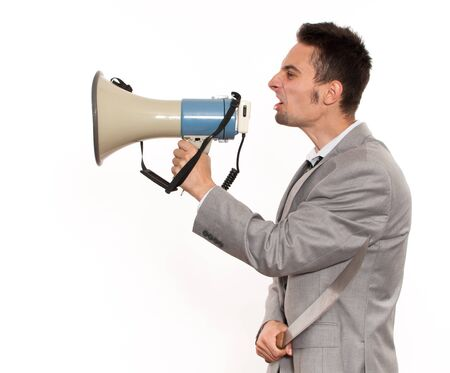 Young crazy businessman with megaphone and machete Stock Photo - 14957506