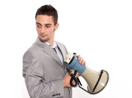 Handsome young caucasian mysterious businessman with megaphone
