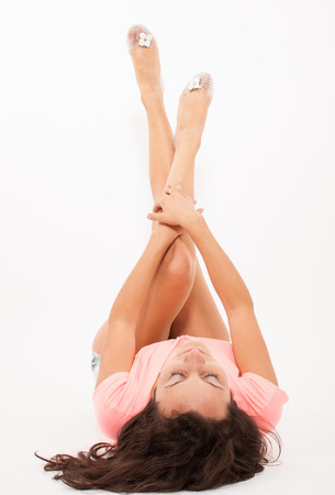 Attractive young woman with raised legs Stock Photo