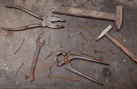 Workbench with rusty tools Фото со стока