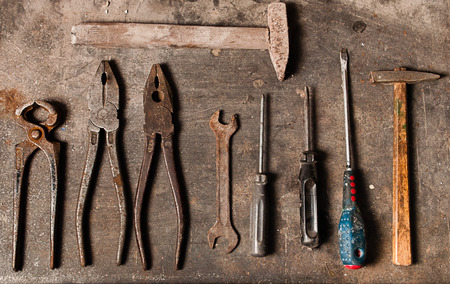 Workbench with rusty tools Stock Photo