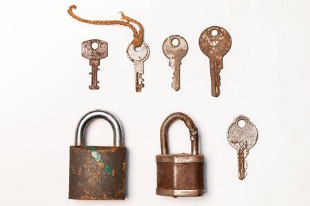 Old rusty lock and key Фото со стока