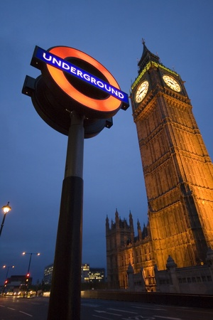 London, UK, 19 January 2011 - the Famous underground Logo and the big ben tower, a typical London scene, good for editorial Content on the English city