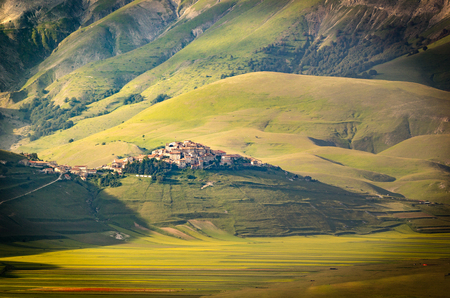 sibillini: Castelluccio di Norcia, Umbria, Italy. View of the town from the valley Stock Photo