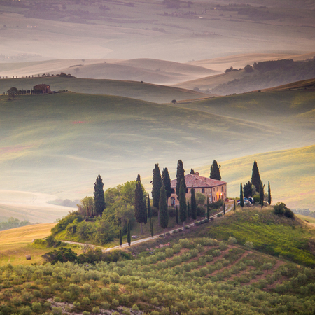 san quirico: Val dOrcia, Tuscany, Italy. A lonely farmhouse with cypress and olive trees, rolling hills.