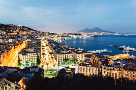 Naples, Campania, Italy. View of the bay by night and Mount Vesuvius Volcano in background Imagens