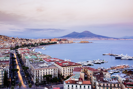 Naples, Campania, Italy. View of the bay by night and Mount Vesuvius Volcano in background Stock Photo