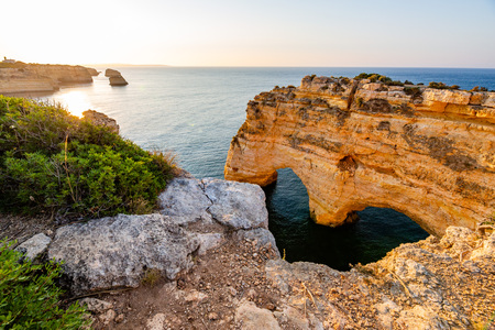 Praia da Marinha, Algarve, Portugal. Sunrise and heart shaped rock