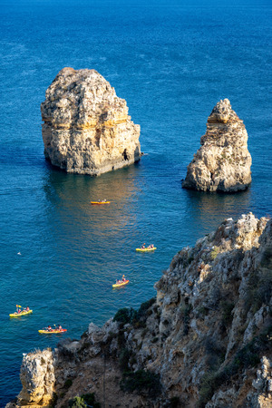 Seascape and kayaks in Algarve, Portugal.