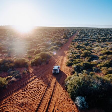 Off road desert adventure, car and tracks on sand in the Australian Outback. Western Australia