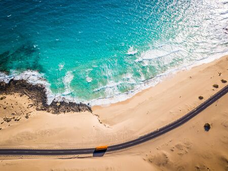 Directly above road and ocean beach at Corralejo sand dunes, Fuerteventura, Canary Islands Reklamní fotografie