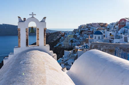 Santorini, Cyclades Islands, Greece. White houses and churches in summer Фото со стока