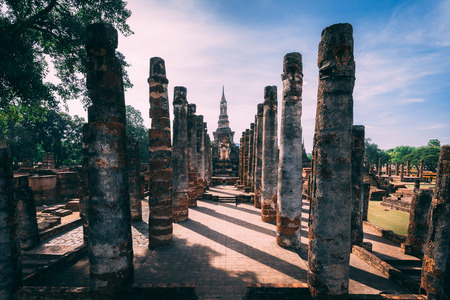 Temple complex in Sukhothai, Thailand. Beautiful  historic park in the middle of Thailand. One man in the middle of the Temple. Shows the enormous scale of the temple.