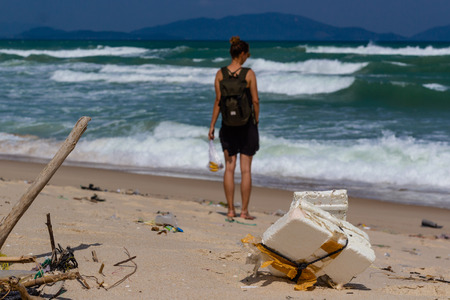 Beach pollution, plastic and waste from ocean on the beach. tourist on the polluted beach Reklamní fotografie