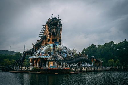 Dark tourism attraction Ho Thuy Tien abandoned waterpark, close to Hue city, Central Vietnam, Southeast Asia. Famous Dragon statue in the middle of the waterpark. Фото со стока