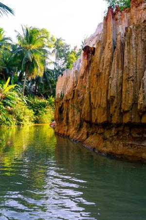 Fairy Stream Canyon. Red river between rocks and jungle. Mui Ne. Vietnam.