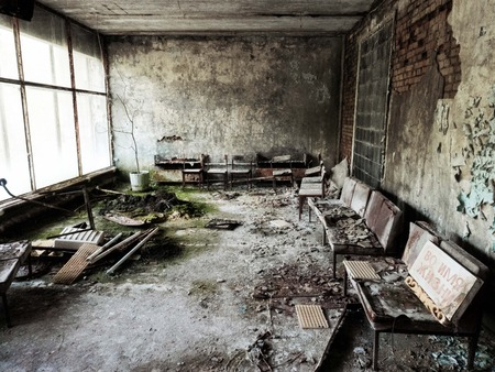 Pripyat city of ghost and playground abadoned cars. Famous hospital waiting room