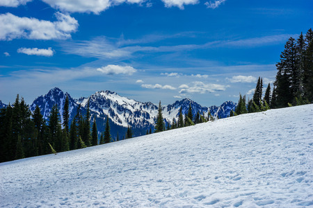 Snow topped mountain with blue sky and negative space Stock Photo