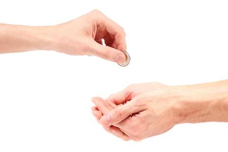 limosna: la mano dan la moneda a mendigo