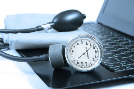 high blood pressure: Blood pressure instrument on a computer keyboard Stock Photo