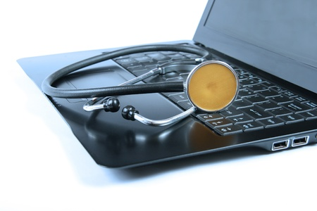 Stethoscope on a laptop keyboard photo
