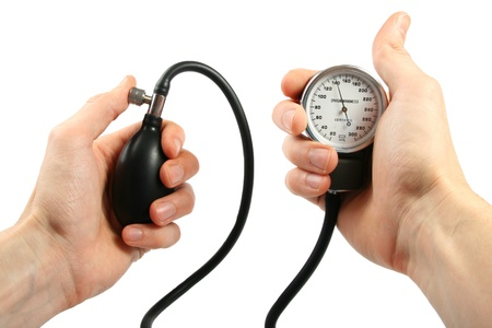 sphygmomanometer: Blood pressure gauge in the hands Stock Photo