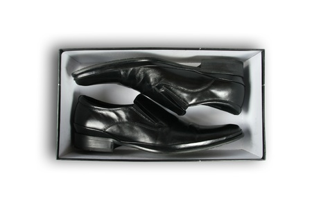 Pair of black leather shoes inside a box photo