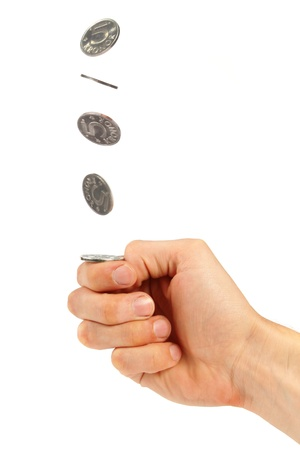 decisions: hand flipping a coin Stock Photo