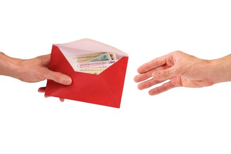 bribe: Hand hold envelope with money